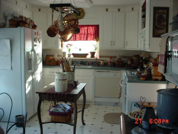 My Primitive/Country Kitchen, As you can see, the kitchen was quite green and white.  I had lovely green and white linoleum to match the countertop.  I painted the cabinets,added new hardware, stainless appliances, lighting and made it my own., Kitchens Design