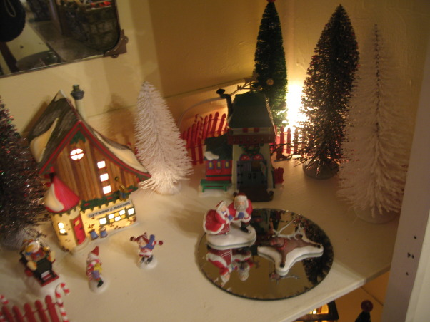 NorthWest Home For The Holidays, Welcome to our new home for it's very first Christmas.  Please make yourself at home., Department 56 North Pole buildings in a vintage cabinet.    , Holidays Design