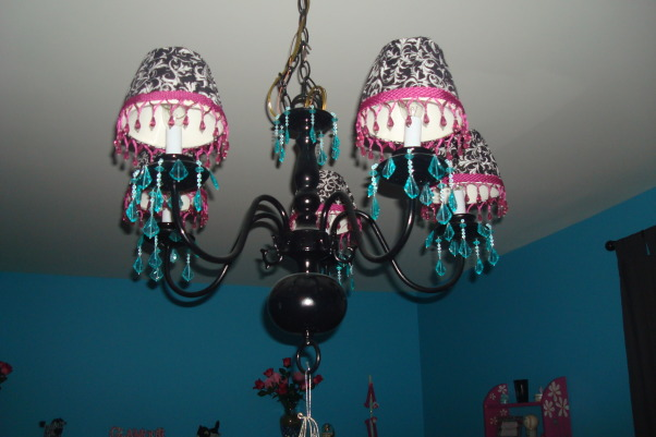 8 year old fun space, My 8 year old daughter wanted a fun bedroom that she felt grown up in.  She is very happy with the way it turned out., We bought this chandelier on Craigs List and painted it.  The shades came with it but we covered them and added jewels., Girls' Rooms Design