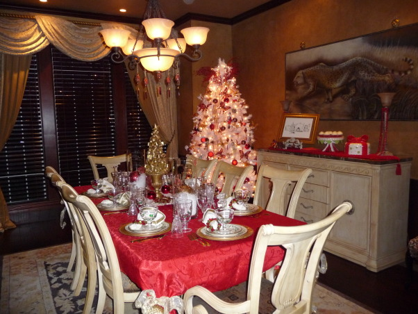 Magical Christmas 2009, I created this space with children in mind. I use my kids toys, old books and a collection of toy soldiers and elves to createa fun and magical space. I have seven trees this year but the entry tree with all of our handmade ornaments and memories from our past is one of my favorites. , My dining room table is set for brunch. I like to mix and match glasses. The white tree is filled with butterflies, family photos in jeweled frames and elegant ladies. I filled two large vases with snow and added a beautiful ornament to each. I used a large serving tray for the centerpiece and layered it with snow and ornaments and jeweled napkin rings. Very cost effective. , Holidays Design