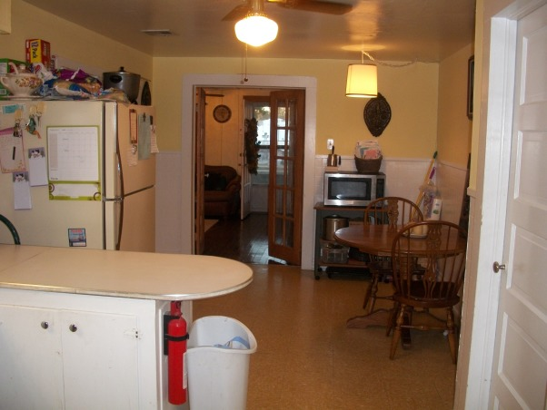 "Weird Kitchen Space with no flow or storage, My kitchen lacks storage and has absolutely no flow in my house.  I have a very small ""shotgun"" home in south Louisiana.  It is very cozy and homey but my kitchen is an eye sore and I have no clue what to do!!!  Help please!!!!, Hate how the island cuts everything off! , Kitchens Design"