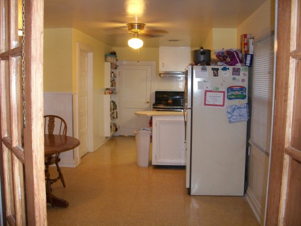 "Weird Kitchen Space with no flow or storage, My kitchen lacks storage and has absolutely no flow in my house.  I have a very small ""shotgun"" home in south Louisiana.  It is very cozy and homey but my kitchen is an eye sore and I have no clue what to do!!!  Help please!!!!, Very narrow.  Hate that my fridge is away from everything else.  (FYI  replacing it soon to match other appliances) , Kitchens Design"