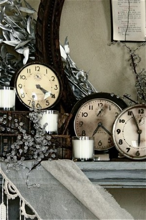 New Year's Eve - A Moment in Time, Close up of the end of the mantle. Old vintage clocks for the theme: A Moment in Time.  , Holidays Design