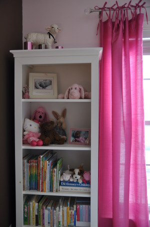 Hot Pink Room, Hot pink window treatment and storage cubes were inspired by the night lamp, which was the first purchase.  Still looking for the perfect bedding that won't clash with the wall art and the cherry blossoms rug., This bookcase provides storage for her books and some of her toys  , Girls' Rooms Design