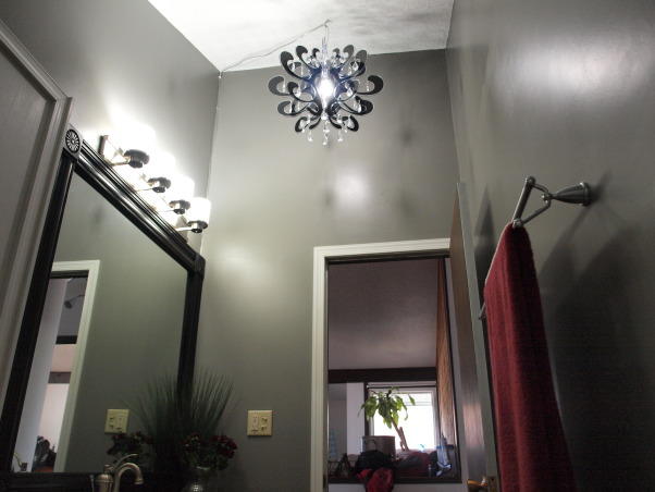 From 70's Retro to Clean and Modern, We recently bought this home built in 1975 and the bathroom hadn't been redecorated (or cleaned) since!  We took care of the problem for under $500., AFTER:  Black acrylic and crystal chandelier hangs in the high ceiling.   , Bathrooms Design
