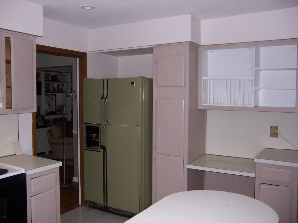 Kitchen reborn, an updated 60's kitchen, We made the most of our existing space by opening up walls (no structural walls) and replacing windows.  An unusual appliance arrangement allowed us to have a big country kitchen island .  Also allowed us to get rid of our old avocado refrigerator!, Before of our 60's kitchen had a avocado covered refrigerator which we were happy to see go!       , Kitchens Design