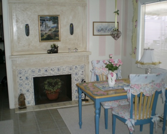 "Mobile Home Makeover, Makeover of my 90 y/o mother-in-law's '60's mobile home that was a DISASTER and ""decorated"" as such!!  Transformed it into a cute Granny's Cottage., My Mother-in-law's dining room AFTER.  The ""fireplace"" is fake...I framed it out w/2x4's and created the ""tiles"" on drywall w/spackling, then painted it to resemble Delft tiles (I got this idea from a magazine).   , Dining Rooms Design"