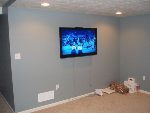 Unfinished Basement/Laundry Area, From an unfinished concrete basement to a finished gameroom/family room, Finished TV Wall , Basements Design