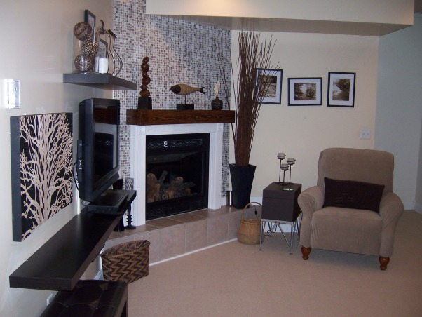 """Basement redo, I tiled my fireplace and added a mantle.  Love the neutral colors., I used glass tile and had a custom mantle built.  I also mounted our flat-screen TV and hung some floating shelves as an """"entertainment center""""., Basements Design"""