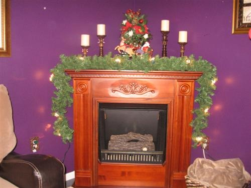 corner fireplace decorating, I love my Gel Fireplace but sometimes it can be hard to decorate.it looks and sounds just like a real wood burning FP. It looks it's best at Christmas time,so full and warmth of lights and garland.I constantly am rearranging items on it.  Please dont rate it,just give some decorating ideas., Lights on the garland.I did add ornaments and ribbon and other things to it when I found the finished look., Living Rooms Design