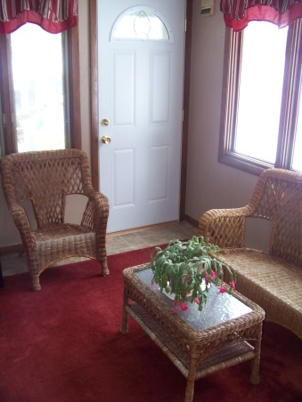 Four Seasons Room, This is a very small room between our mudroom and kitchen.  Two of the walls are completely windows.  The other walls both have doors.  There is a lot of traffic through here on a daily basis and it also provides a great space to sit and watch the kids playing in the backyard., Should I paint the wicker furniture black to make it pop off of the wall color or leave them as they are? What do you think?, Porches Design