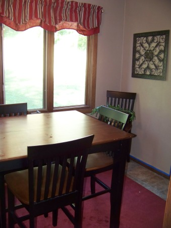 Four Seasons Room, This is a very small room between our mudroom and kitchen.  Two of the walls are completely windows.  The other walls both have doors.  There is a lot of traffic through here on a daily basis and it also provides a great space to sit and watch the kids playing in the backyard., Before we had this large counter height table and chairs set up on the sun porch., Porches Design