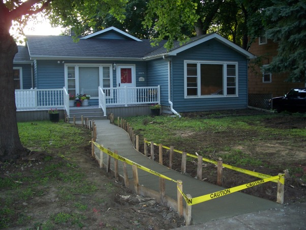 Do It Yourself Porch, Front porch built by homeowner on One leg., Sidewalk goes in. , Porches Design