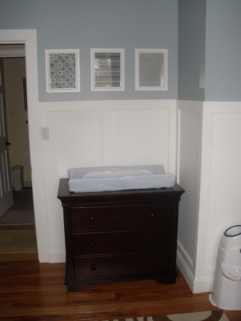 Blue, White & Brown Little Girl Nursery, We decided to go with blue, white & brown colors for our little one.  We made the decision before we found out we were having a girl. We figured either way we'd love the color combo. We installed Brazilian Coa Hardwood, and my husband made the wainscotting for the room.  (His first major DIY projects), I framed coordinating scrapbook paper for artwork. It was inexpensive, and easier for me to find something that matched. :)  We are using the dresser top as our changing station. , Nurseries Design