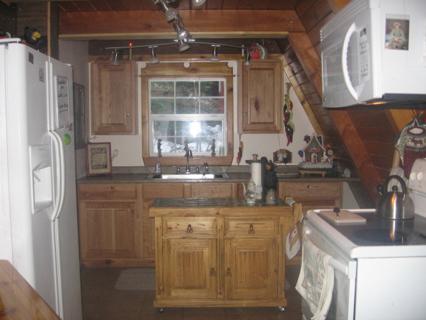 a frame kitchen, it is small and alot of wasted space ,would like to improve this space, this is my small kitchen I am looking for more usable space but love my hickory cabents, Kitchens Design