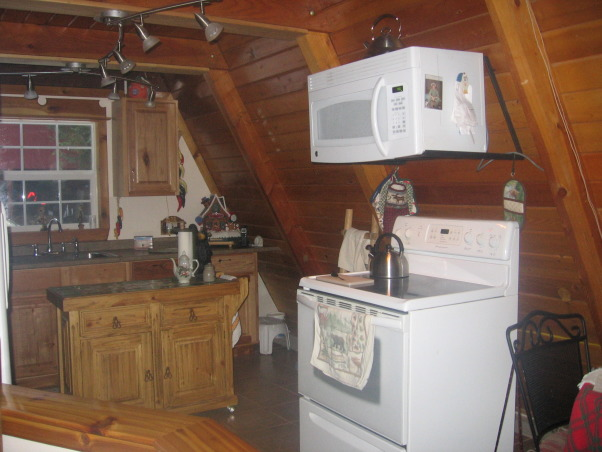 a frame kitchen, it is small and alot of wasted space ,would like to improve this space, different angles, Kitchens Design