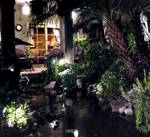 Vacation at Home, Peacefull place to entertain and hang out, 3000 gallon koi pond seems to go under back porch seating area.  , Home Exterior Design