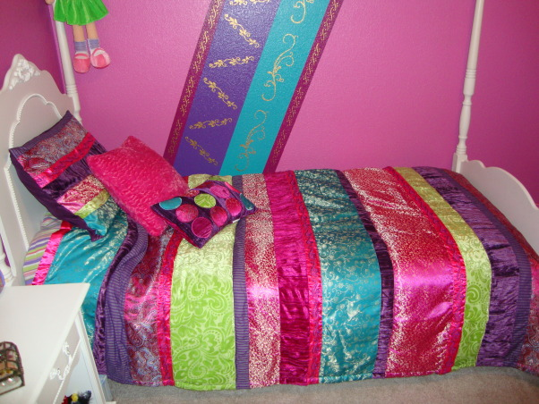 Rich Colors for an 8 year old, Girl's bedroom makeover.  Pink, turquoise, purple, and raspberry colors.  Striped comforter set and painted stripes on walls with gold stencils.  , Another picture of the comforter set with paint color., Girls' Rooms Design
