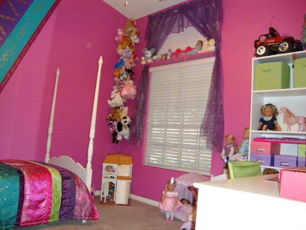 Rich Colors for an 8 year old, Girl's bedroom makeover.  Pink, turquoise, purple, and raspberry colors.  Striped comforter set and painted stripes on walls with gold stencils.  , We hung a stuffed animal chain that I purchased through Amazon and got purple curtains.  They are not quite long enough with the two windows, but with my daughter being 8 years old shorter is always best.  I made a bracelet with beads to make the colors and used that as a curtain tie back near shelf.  I added a shelf between the two windows so my daughter could put special things on.  The shelf was just painted the same color was the wall color to blend in. , Girls' Rooms Design
