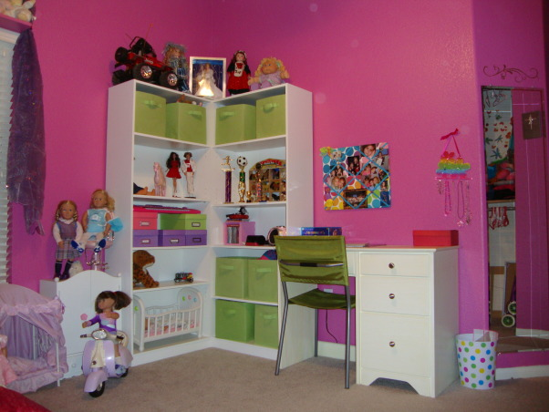 Rich Colors for an 8 year old, Girl's bedroom makeover.  Pink, turquoise, purple, and raspberry colors.  Striped comforter set and painted stripes on walls with gold stencils.  , Storage shelves with desk.  These shelves were just purchased at an office store then put together.  I just put the shelves together in the corner to make it look more custom, but it isn't.  The desk I got at an unfinished wood store and just painted white and placed next to shelves.  A bulletin board with my daughter's favorite pictures and her jewerly hang over the desk.  I got fabric storage boxes from the home improvement store to match the room and hide stuff., Girls' Rooms Design