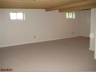 L-Shaped Basement design?, First, I'm a single guy, moved into my house a year ago, and have no eye for design.  At the moment, my basement has leftover furniture that couldn't fit in my living room, and little extras I found before moving in.  I'd like to make it into a movie room and have a bar.  There is a long stretch that I'm not sure what to do with.  I plan on finishing the ceiling once all the wiring is in place.  HELP! :), Around the corner   , Basements Design
