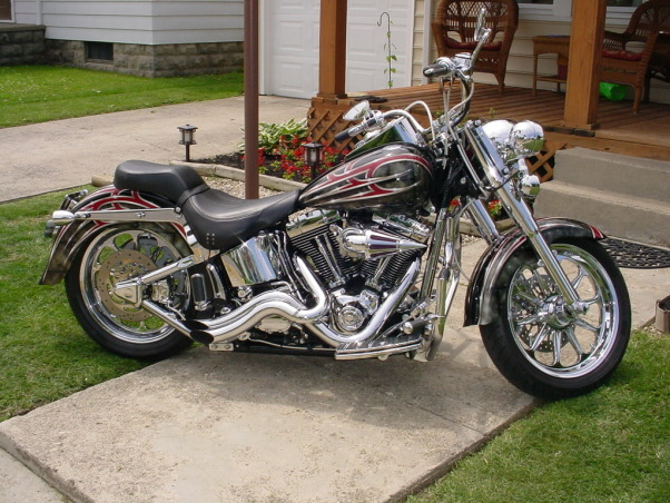 Harley Garage, I installed PVC Diamond Plate Floor Tile Painted walls Black and Orange Decorated in Harley Memorabilia. Harley Pay Phone Professional Poker Table Shelf with Harley Mini Grandfather Clock and so forth. How did I do? , New picture of bike after more work done. Added pipes, air breather, lowered the back. not to mention the chrome accessories...kinda lost count. , Garages Design