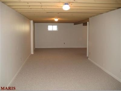 L-Shaped Basement design?, First, I'm a single guy, moved into my house a year ago, and have no eye for design.  At the moment, my basement has leftover furniture that couldn't fit in my living room, and little extras I found before moving in.  I'd like to make it into a movie room and have a bar.  There is a long stretch that I'm not sure what to do with.  I plan on finishing the ceiling once all the wiring is in place.  HELP! :), Before furniture, when you walk down the stairway and enter the basement   , Basements Design
