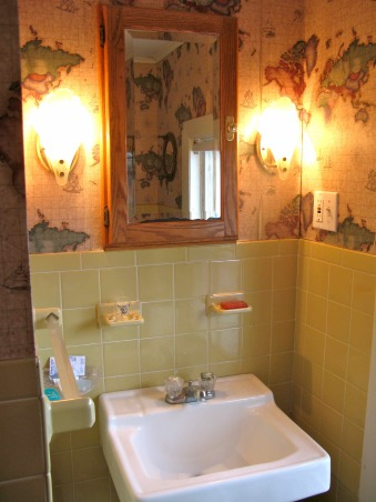 Yellow-Tile Bathroom Makeover: It's finally done. What do you think?, Here's the upstairs bathroom in my 162-year-old house. Take a look at these before and after photos of this bathroom and let us know what you think. You can learn more about the details of this makeover at: http://tinyurl.com/2eg7q2d .  And you can watch an audio-slideshow of the new bathroom here: http://tinyurl.com/29rrcel, BEFORE: Although I love this large wall sink, it doesn't offer any storage space. So I plan to replace it with a dark cherry vanity with a white ceramic bowl sink. The medicine cabinet and scones will also be replaced.    , Bathrooms Design