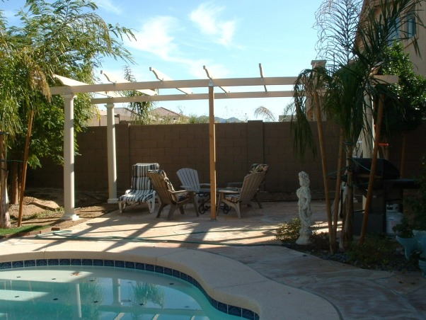 A Back Yard Get Away want-a-be, Backyard is an ongoing process.  It was nothing but dirt when we 1st started and it is now 2 years later and we are almost done, but still not excited over it.  , 2/19 To save money, my husband is building the pergola. Not finished yet.  Our plan is to add drapes on each side of the frame, a yellow pot in front of the right & left post with a plant in each; lattice at the back to give more privacy from the neighbors and a flowering vine to grow through it.  We are not sure whether to put lattice on the tom for more shade or something else.  It gets VERY hot here, so we need something that will withstand the heat.  My husband is planning to put a barbecue to the far right.  When finished, we will put a nice patio set inside. We CAN'T WAIT!!    , Yards Design