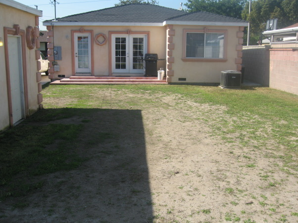 Ugly Backyard Needs Help, We bought our home 3 months ago and we have a backyard that is ~2000 sqft. but its empty, dirt everywhere with tons of weeds growing all over the place.  We need some ideas.  We want a nice space for our 3 young children and our German Shepard.  Budget is very tight with about $500 right now and about $100 a month to invest.  Current plan is to till the ground, grade for runoff and seed grass. We're able to put in the time and effort necessary to get this done, but we're both completely unexperienced and have no imagination., Here's the back side of our home.  We intend to paint the house gray with white trim as the peach/pink isn't appealing to us.       , Yards Design
