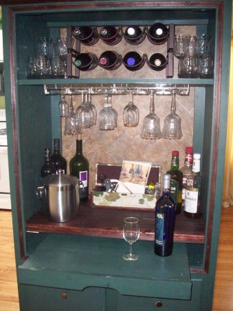 Armoire becomes Bar, TV armoire converted into a bar, I added a light behind the shelf (the under the counter kind for cabinets)  The light adds just enough lumination.  The shelf still pulls out and can be used for more counter space. , Other Spaces Design