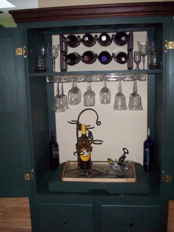 Armoire becomes Bar, TV armoire converted into a bar, First I added the wine racks and the under the shelf glass racks, Other Spaces Design