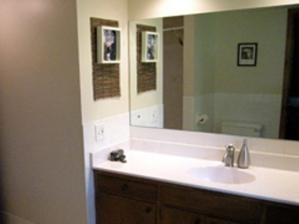 small bathroom makeover, Modern small bathroom featuring a pebble rock wall!!!!  tv in mirror - Cool!, boring, Bathrooms Design