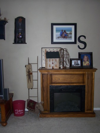 Country bi level, This is our home, we live in a bi level. so it is alittle hard to arrange furniture. I love primitive decorating. Just wanted to share pics and get some advice or ideas?? Thanks all!!!!, fireplace is electric, some may say cheesy but I love it!!!     , Living Rooms Design