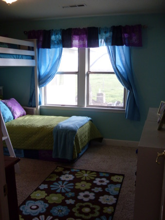 A Little Bit Cowgirl, This is a room for 9 and almost 11 year old sisters who live on a 30 acre horse ranch and love to ride horses. They agreed on a turquoise room and I threw in lime green for one and purple for the other., This is the view from the door., Girls' Rooms Design