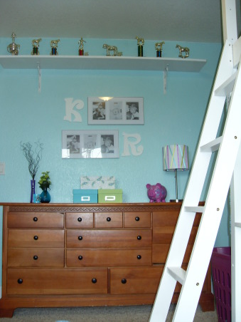 A Little Bit Cowgirl, This is a room for 9 and almost 11 year old sisters who live on a 30 acre horse ranch and love to ride horses. They agreed on a turquoise room and I threw in lime green for one and purple for the other., Their dresser, shelf to hold their trophy's, photo boxes to hold precious junk, lamp which I dressed up with ribbon, the other piggy bank, vases and photo display with the girls initials. The dresser will be sanded down and painted white, but I ran out of time. , Girls' Rooms Design
