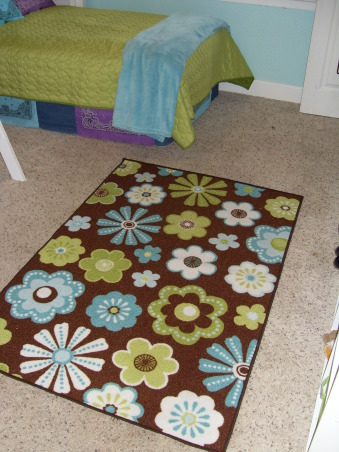 A Little Bit Cowgirl, This is a room for 9 and almost 11 year old sisters who live on a 30 acre horse ranch and love to ride horses. They agreed on a turquoise room and I threw in lime green for one and purple for the other., The great rug that was a lucky find at Marshals., Girls' Rooms Design