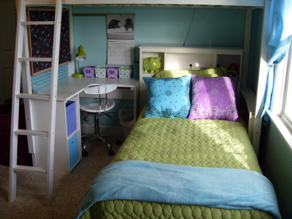 A Little Bit Cowgirl, This is a room for 9 and almost 11 year old sisters who live on a 30 acre horse ranch and love to ride horses. They agreed on a turquoise room and I threw in lime green for one and purple for the other., One of the beds and the custom built desk. The head board and desk chair are from Walmart, bedding, piggy bank, lamp and boxes on the desk are from Target and I sewed the Bandanna Pillows. , Girls' Rooms Design