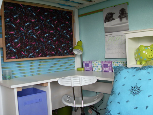 A Little Bit Cowgirl, This is a room for 9 and almost 11 year old sisters who live on a 30 acre horse ranch and love to ride horses. They agreed on a turquoise room and I threw in lime green for one and purple for the other., A closer look at the desk area. A store bought bulletin board dressed up with stapled on fabric that I fell in love with at the fabric store and had to work in somehow. Also lime green cork board strips. , Girls' Rooms Design