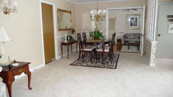 Rug or no rug for dinning area, How many rugs are to much? Not sure if they work together. This rug was originally purchased for the adjacent sun room/tv room. Is it to much to have three area rugs within the same sight line. OR should I stick to the original plan of building/updating the adjacent sun room around this carpet? Need help. Is this dark chocolate brown rug to dark? If the rug remains in the DR should I change the wall paper?, Dinning area of LR space.       , Dining Rooms Design