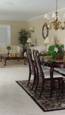 Rug or no rug for dinning area, How many rugs are to much? Not sure if they work together. This rug was originally purchased for the adjacent sun room/tv room. Is it to much to have three area rugs within the same sight line. OR should I stick to the original plan of building/updating the adjacent sun room around this carpet? Need help. Is this dark chocolate brown rug to dark? If the rug remains in the DR should I change the wall paper?, LR Dinning area with rug.       , Dining Rooms Design