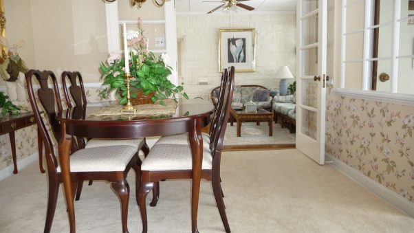 Rug or no rug for dinning area, How many rugs are to much? Not sure if they work together. This rug was originally purchased for the adjacent sun room/tv room. Is it to much to have three area rugs within the same sight line. OR should I stick to the original plan of building/updating the adjacent sun room around this carpet? Need help. Is this dark chocolate brown rug to dark? If the rug remains in the DR should I change the wall paper?, Another view without rug. Note the sun room has an area rug and needs one since this room is on a slab and the floor is cold.      , Dining Rooms Design