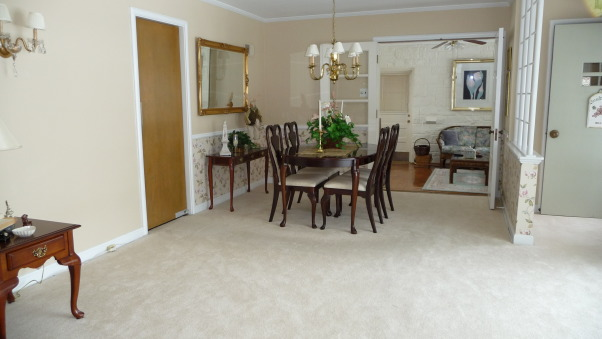Rug or no rug for dinning area, How many rugs are to much? Not sure if they work together. This rug was originally purchased for the adjacent sun room/tv room. Is it to much to have three area rugs within the same sight line. OR should I stick to the original plan of building/updating the adjacent sun room around this carpet? Need help. Is this dark chocolate brown rug to dark? If the rug remains in the DR should I change the wall paper?, Rug or no rug.        , Dining Rooms Design