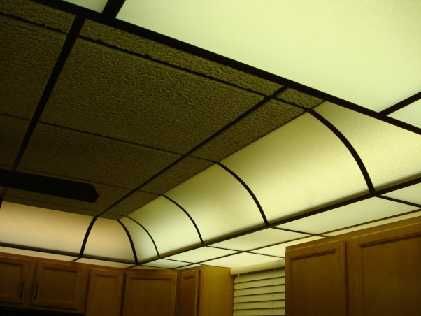 My 1990's kitchen, I have updated the kitchen since purchasing my home in the 90's. It had dark paneling and wall paper. But now I am ready to have a built in dishwasher, new cupboards and replace the table with an island for more storage., This is the California ceiling I mentioned. It is florescent lights behind frosted lenses. It has two wall controls, one for the sink area and one for the balance of the kitchen. The kitchen is small, 9 X 12. What I like is you are never in your own shadow when working as the light difusses the area quite nicely., Kitchens Design