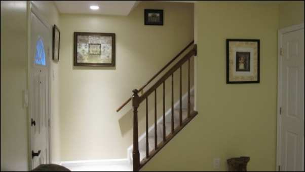 Teeny-Tiny Living Room, Stairwell landing - we are going to paint the banister white and black (the spirals white, the railing black) come spring  , Living Rooms Design