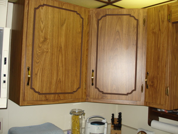 My 1990's kitchen, I have updated the kitchen since purchasing my home in the 90's. It had dark paneling and wall paper. But now I am ready to have a built in dishwasher, new cupboards and replace the table with an island for more storage., Old wrapped cupboards. , Kitchens Design