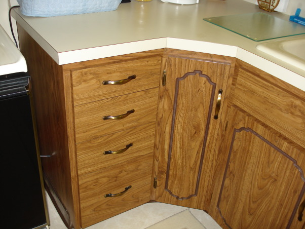 My 1990's kitchen, I have updated the kitchen since purchasing my home in the 90's. It had dark paneling and wall paper. But now I am ready to have a built in dishwasher, new cupboards and replace the table with an island for more storage., Countertop was formica. , Kitchens Design