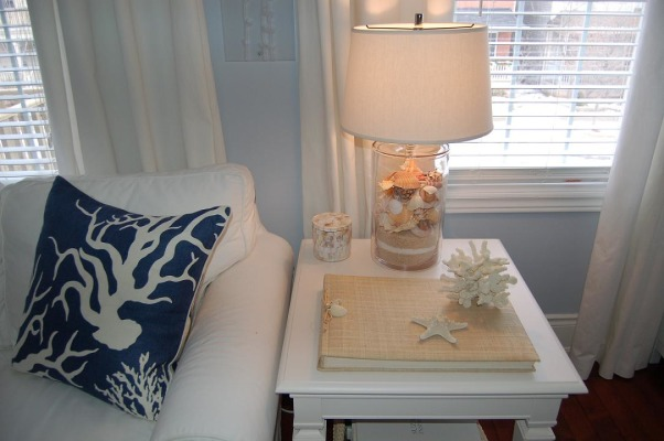 Beachy Family Room Updates, I've posted our Family room previously, but have recently made a few more (decorating) updates. Artwork now hung, new accessories etc..., My new coral pillow (Thomas Paul) Love his cushions! , Living Rooms Design