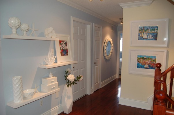 Beachy Family Room Updates, I've posted our Family room previously, but have recently made a few more (decorating) updates. Artwork now hung, new accessories etc..., Finally had pictures framed (brightly coloured seascapes of Nova Scotia south shore) Still need to paint this yellow wall leading upstairs...paint it white or a light sand colour. Why do whites have to be so hard to get right??  this pic has a round mirror down the hallway...or I can go with another one I have (next picture) , Living Rooms Design