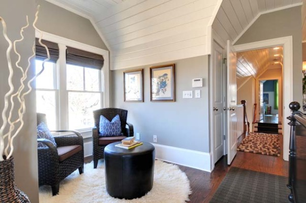 Cottage Master Suite with Open Bathroom, Set within the eaves of a front-gable Victorian cottage, this master suite has an open bedroom/bathroom concept, complete with a Japanese soaking tub., Sitting room, and view out to hallway., Bedrooms Design
